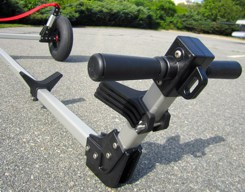 Eyelets on handle fitting allow boats to be easily secured to the dolly